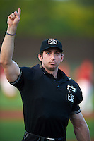 Umpire Matt Scott during a game between the Mahoning Valley Scrappers and Auburn Doubledays on September 4, 2015 at Falcon Park in Auburn, New York.  Auburn defeated Mahoning Valley 5-1.  (Mike Janes/Four Seam Images)