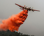 Cal Fire Air Tanker drops retardant on Division S, below Pilot Peak, at Old Yosemite Road, to protect the Greeley Hill community after spot fire escaped the southwest corner of the Rim Fire the night before.