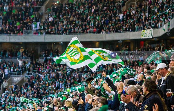 Stockholm 2014-11-02 Fotboll Superettan Hammarby IF - J&ouml;nk&ouml;pings S&ouml;dra IF :  <br /> Hammarbys supportrar med flaggor under matchen mellan Hammarby IF och J&ouml;nk&ouml;pings S&ouml;dra IF <br /> (Foto: Kenta J&ouml;nsson) Nyckelord:  Superettan Tele2 Arena Hammarby HIF Bajen J&ouml;nk&ouml;ping S&ouml;dra IF J-S&ouml;dra supporter fans publik supporters jubel gl&auml;dje lycka glad happy glad gl&auml;dje lycka leende ler le