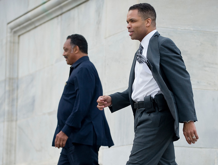 Rev. Jesse Jackson and Rep. Jesse Jackson, Jr., D-Ill., walk down the House steps together after a series of votes on the House floor as Congress attempts to pass healthcare reform on Sunday, March 21, 2010.