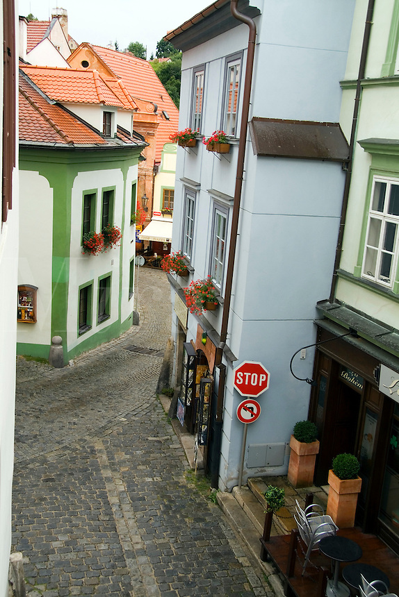 Quaint street of cobblestone and old buildings in tourist city of Cesky Krumlov in Czech Republic