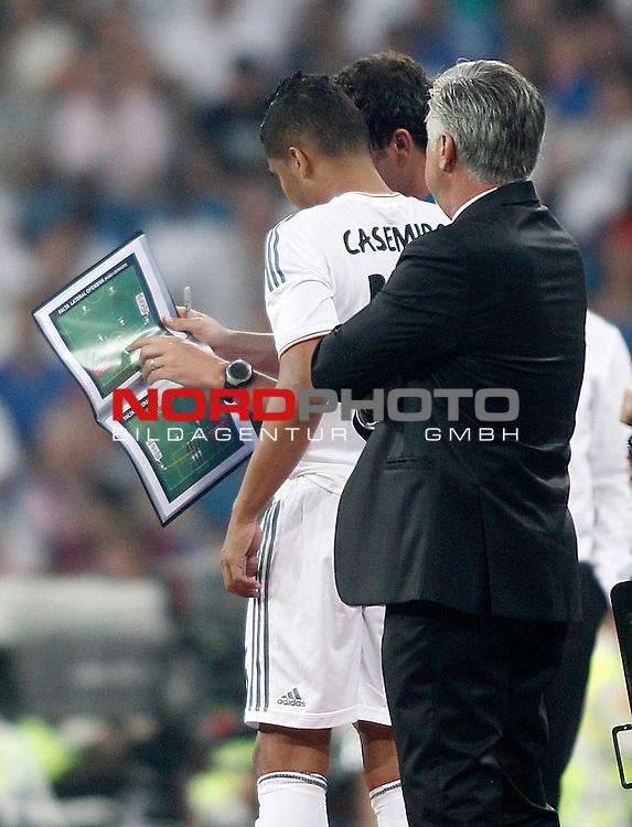 Real Madrid's Casemiro looks the book of tactics during La Liga match.August 18,2013. Foto © nph / Acero)