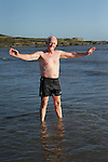 Jim Gavin from Spain (ex-Collon) during the St. Stephen's Day 2013 swim for Chernobyl on Clogherhead beach.<br /> Picture:  Thos Caffrey / www.newsfile.ie