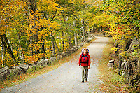 Woman walking carriage road, Acadia National Park, Hancock County, Maine, US
