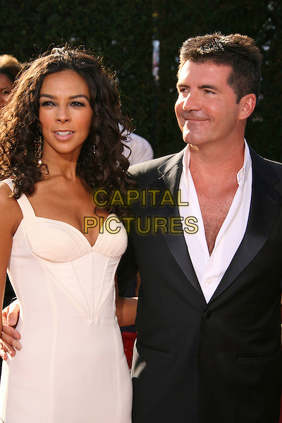 TERRI SEYMOUR & SIMON COWELL.59th Annual Primetime Emmy Awards held at the Shrine Auditorium, Los Angeles, California, USA,.16 September 2007..half length white dress.CAP/ADM/RE.©Russ Elliot/AdMedia/Capital Pictures.