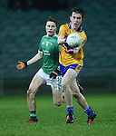 Conall O hAinifein of Clare  in action against Daniel Enright of Limerick during the Mc Nulty Cup U-21 final at The Gaelic Grounds. Photograph by John Kelly.