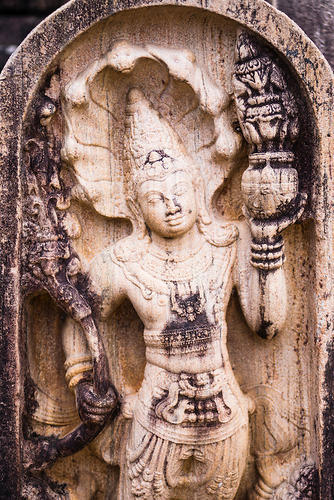 Ancient City of Polonnaruwa, architectural detail of a carved stone guardian statue at the Vatadage (Circular Relic House) in Polonnaruwa Quadrangle, UNESCO World Heritage Site, Sri Lanka, Asia. This is a photo of the architectural detail of a carved stone guardian statue at the Vatadage (Circular Relic House) in Polonnaruwa Quadrangle at the Ancient City of Polonnaruwa, a UNESCO World Heritage Site in Sri Lanka, Asia.