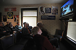 Visitors watch a movie about former U.S. President Ronald Reagan before touring his boyhood home in Dixon, Illinois on October 26, 2008.