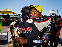May 21, 2017; Topeka, KS, USA; NHRA top fuel driver Steve Torrence (left) hugs Antron Brown during the Heartland Nationals at Heartland Park Topeka. Mandatory Credit: Mark J. Rebilas-USA TODAY Sports