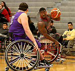 MARSHALL, MN - MARCH 17:  Dequel Robinson #22 from Alabama controls the ball against the University Wisconsin Whitwater during their championship game at the 2018 National Intercollegiate Wheelchair Basketball Tournament at Southwest Minnesota State University in Marshall, MN. (Photo by Dave Eggen/Inertia)