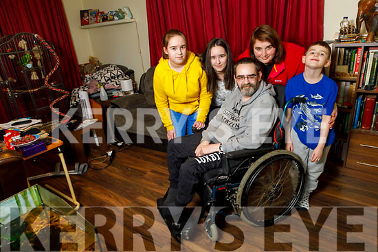 Darren Lavery and his wife Nadine with daughters Alannah and Laoise and son Nuadha at home in Listowel on Tuesday. Who have set up a gofundme page to raise money for an Ipad and an App to record his voice so he can still speak to his kids.