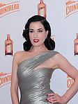 """MIAMI BEACH, FL - NOVEMBER 17: Dita Von Teese attends the official U.S. launch of """"My Cointreau Travel Essentials"""". her latest limited-edition vintage-inspired travel bar accessory at Sunset Lounge at Mondrian South Beach on November 17, 2011 in Miami Beach, Florida. (Photo by Johnny Louis/jlnphotography.com)"""