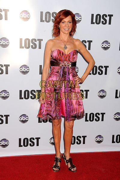 "CARRIE PRESTON.""Lost"" Live: The Final Celebration held at UCLA's Royce Hall, Westwood, California, USA..May 13th, 2010.full length dress strapless pink red hand on hip leopard print brown black sandals dress.CAP/ADM/BP.©Byron Purvis/AdMedia/Capital Pictures."