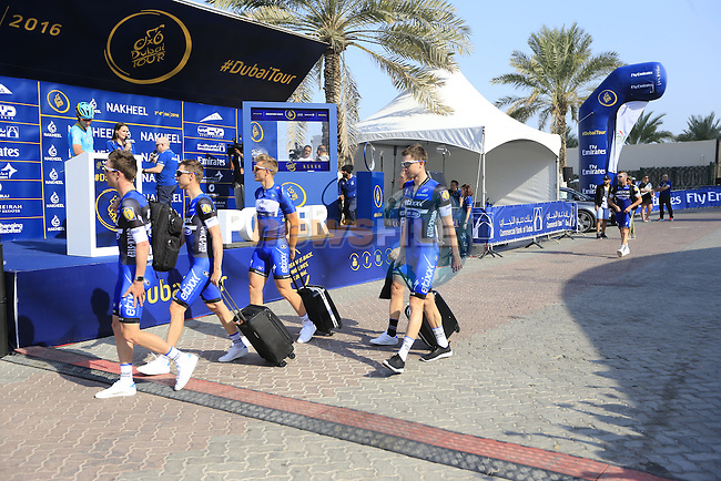 Etixx-Quick Step team arrive for the start of Stage 2, the Nakheel Stage, of the 2016 Dubai Tour starting at the Dubai International Marine Club and running 188km to Palm Jumeirah Atlantis, Dubai, United Arab Emirates. 4th February 2016.<br /> Picture: Eoin Clarke | Newsfile<br /> <br /> <br /> All photos usage must carry mandatory copyright credit (&copy; Newsfile | Eoin Clarke)