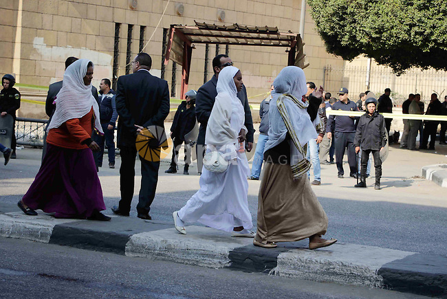 Members of the special police forces stand guard outside the Saint Peter and Saint Paul Coptic Orthodox Church in Cairo's Abbasiya neighbourhood after it was targeted by a bomb explosion on December 11, 2016, . The blast killed at least 25 worshippers during Sunday mass inside the Cairo church near the seat of the Coptic pope who heads Egypt's Christian minority, state media said. Photo by Amr Sayed