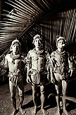 INDONESIA, Mentawai Islands, Kandui Resort,  portrait of Mentawai men standing side by side (B&W)