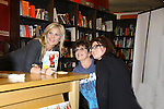 """Days Of Our Lives and Biggest Loser Alison Sweeney poses with fans as she signs her new book """"The Mommy Debt"""" on January 4, 2011 at Borders, Columbus Circle, New York City, New York. (Photo by Sue Coflin/Max Photos)"""