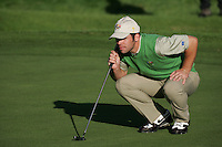Straffin Co Kildare Ireland. K Club Ruder Cup...European Ryder cup team member Paul Casey lining up his putt on the forth green during the opening fourball session of the first day of the 2006 Ryder Cup, at the K Club in Straffan, Co Kildare, in the Republic of Ireland, 22 September 2006..Photo: Fran Caffrey/ Newsfile..