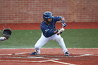Justin Guy (1) of the Wingate Bulldogs lays down a bunt against the Concord Mountain Lions at Ron Christopher Stadium on February 1, 2020 in Wingate, North Carolina. The Bulldogs defeated the Mountain Lions 8-0 in game one of a doubleheader. (Brian Westerholt/Four Seam Images)