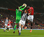 Ben Foster of West Bromwich Albion collects the ball off the head of Romelu Lukaku of Manchester United during the premier league match at the Old Trafford Stadium, Manchester. Picture date 15th April 2018. Picture credit should read: Simon Bellis/Sportimage