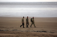 Pictured: Bomb experts at Cefn Sidan beach, near Pembrey west Wales, UK. Saturday 21 May 2016<br />