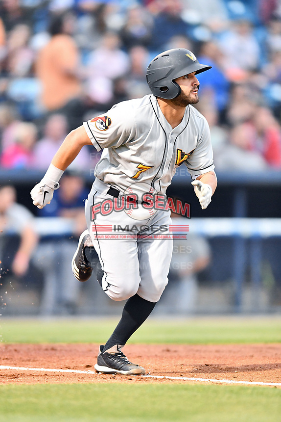 West Virginia Power catcher Manny Pazos (7) runs to first base during a game against the Asheville Tourists at McCormick Field on April 18, 2019 in Asheville, North Carolina. The Power defeated the Tourists 12-7. (Tony Farlow/Four Seam Images)
