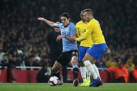 Edinson Cavani of Uruguay shields the ball from Brazil's Arthur during Brazil vs Uruguay, International Friendly Match Football at the Emirates Stadium on 16th November 2018