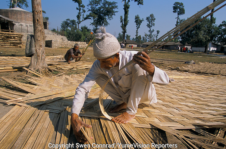 Under UNHCR protection, the life of 135000 Bhutanese refugees in one of the 7 camp near Damak, Nepal. Mens are making wood wall to build new house for the newly come refugees..-The full text reportage is available on request in Word format
