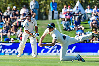 Alastair Cook of England stops a hit from Colin De Grandhomme of the Black Caps during Day 2 of the Second International Cricket Test match, New Zealand V England, Hagley Oval, Christchurch, New Zealand, 31th March 2018.Copyright photo: John Davidson / www.photosport.nz