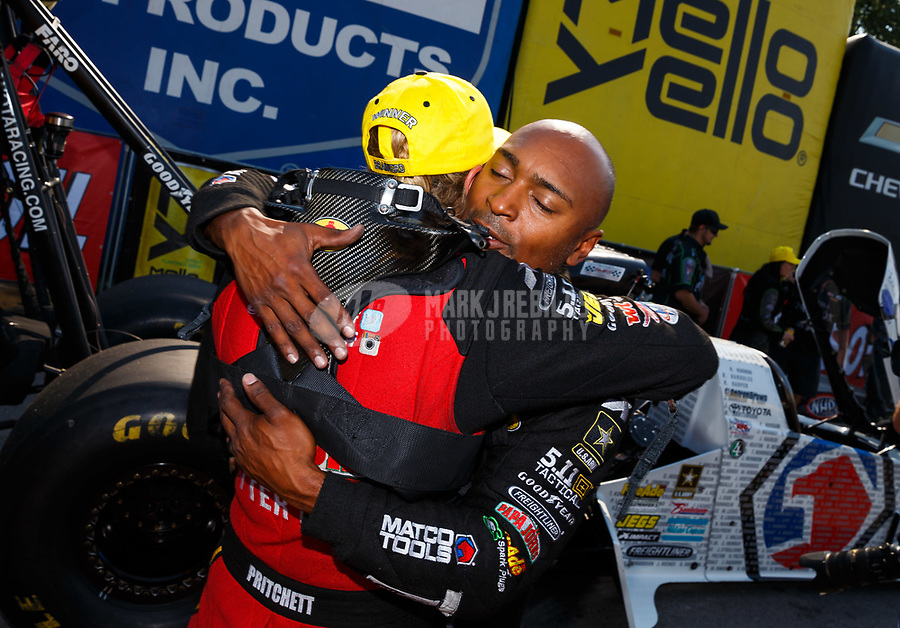 Aug 20, 2017; Brainerd, MN, USA; NHRA top fuel driver Leah Pritchett (left) is congratulated by Antron Brown as she celebrates after winning the Lucas Oil Nationals at Brainerd International Raceway. Mandatory Credit: Mark J. Rebilas-USA TODAY Sports