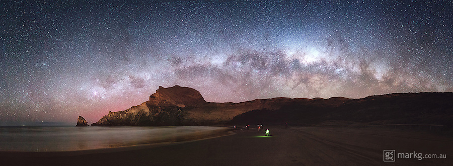 Attendees on the Dark Skies of Wonder astrophotography workshop capture their last shots of the gallactic core of the Milky Way as it begins to set below Castle Rock at Castlepoint in the Wairarapa on the North Island of New Zealand.