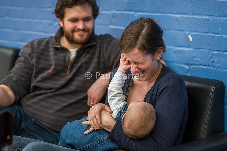 A mother breastfeeds her 5 month old son at a play centre.<br /> <br /> Hampshire, England, UK<br /> 21/03/2016<br /> <br /> © Paul Carter / wdiip.co.uk