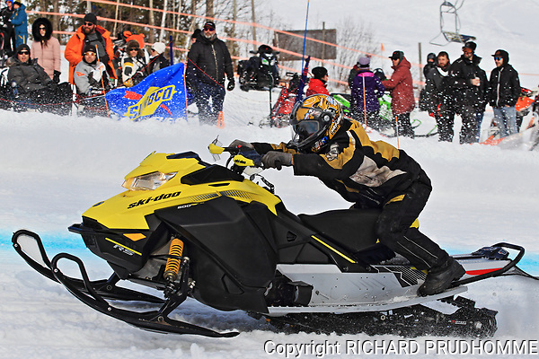 Quebec, Canada.  Snowmobile uphill drag race held on the slopes of Val Saint-Come ski resort