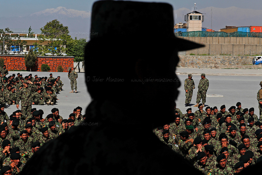 Hundreds of newly graduated Afghan National Army soldiers wait for their deployment orders at a training facility in the outskirts of Kabul, Afghanistan. NATO's initial goal of reaching 320,000 Afghan National Security Forces will be slashed to a mere 220,000 ANSF - many analysts sustain that this is not an adequate number to achieve the security goals of post 2014 Afghanistan (and the year when most NATO troops are scheduled to leave). ..Javier Manzano