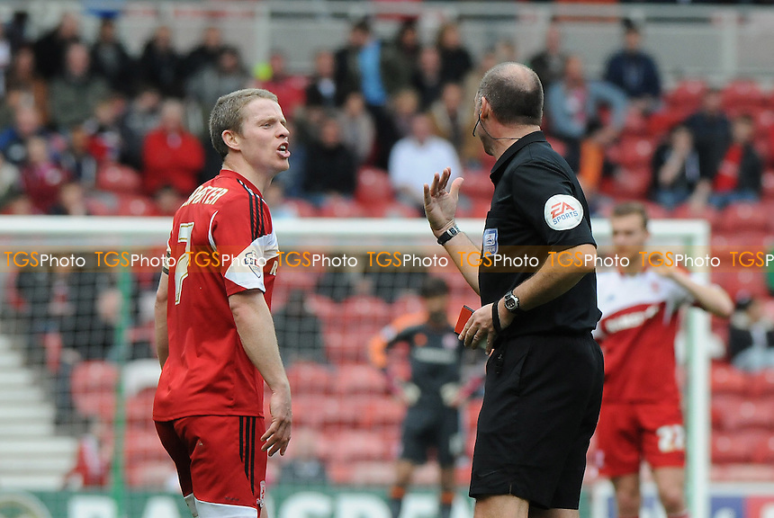 Grant Leadbitter of Middlesbrough complains to referee Andy Haines - Middlesbrough vs Derby County - Sky Bet Championship Football at the Riverside Stadium, Middlesbrough - 05/04/14 - MANDATORY CREDIT: Steven White/TGSPHOTO - Self billing applies where appropriate - 0845 094 6026 - contact@tgsphoto.co.uk - NO UNPAID USE