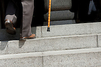 The legs and walking stick of an old man ascending the steps at Toganji temple in Sugamo, Tokyo, Japan Wednesday, April 14th 2010. Sugamo is affectionately known as the old lady Harajuku, in reference to the Mecca for youth fashions in the South of Tokyo, and is a popular place for Tokyo's increasingly aged population.