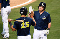 First baseman Dash Winningham (34) of the Columbia Fireflies, right, is congratulated by Brandon Brosher after hitting the second of two home runs in a game against the Lexington Legends on Thursday, June 8, 2017, at Spirit Communications Park in Columbia, South Carolina. Columbia won, 8-0. (Tom Priddy/Four Seam Images)