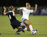 9 November 2007: North Carolina's Erin Mikula (38) and Virginia's Alli Fries (8) challenge for a ball. The University of North Carolina tied the University of Virginia 1-1 at the Disney Wide World of Sports complex in Orlando, FL in an Atlantic Coast Conference tournament semifinal match.  UNC advanced to the finals on penalty kicks, 4-2.