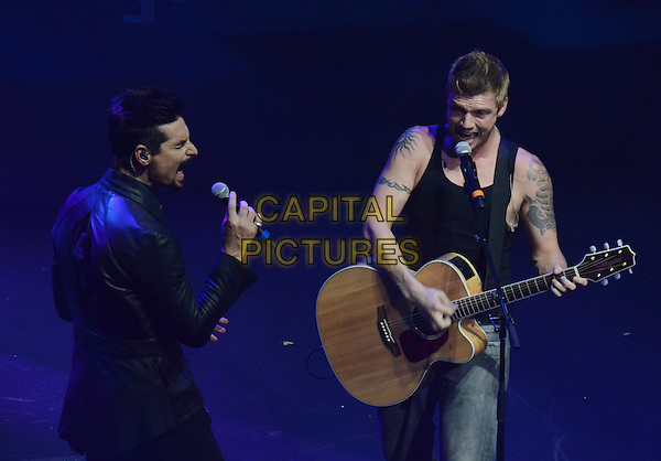 Kevin Richardson, Nick Carter of The Backstreet Boys<br /> Performing live on stage at Macy&rsquo;s Passport Presents Glamorama 2013 - Show - at the Orpheum Theatre, Los Angeles, California, USA, <br /> 12th September 2013.<br /> half length gig concert live on stage music boy band group reunion    playing guitar black vest tattoos suit singing microphone <br /> CAP/ADM/TW<br /> &copy;Tonya Wise/AdMedia/Capital Pictures