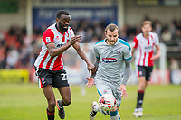 Jamey Osborne of Grimsby  gets past Emmanuel Onariase of Cheltenham Town during the Sky Bet League 2 match between Cheltenham Town and Grimsby Town at the The LCI Rail Stadium,  Cheltenham, England on 17 April 2017. Photo by PRiME Media Images / Mark Hawkins.