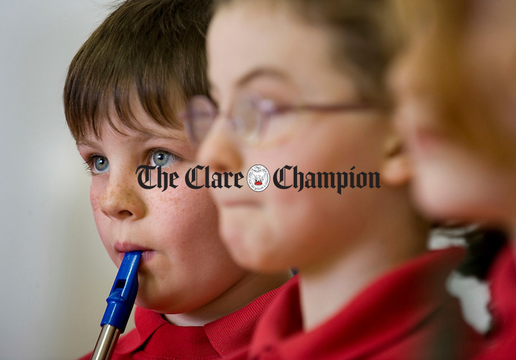 Richie Johnson playing tin whistle at Ballyvaughan NS. Photograph by John Kelly.