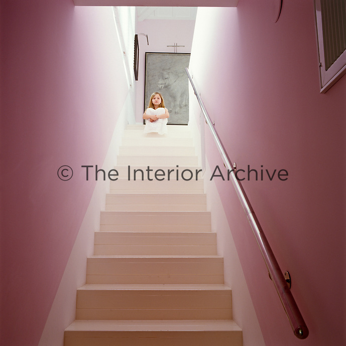 Portrait of Chloe Trigano looking angelic sitting at the top of the staircase