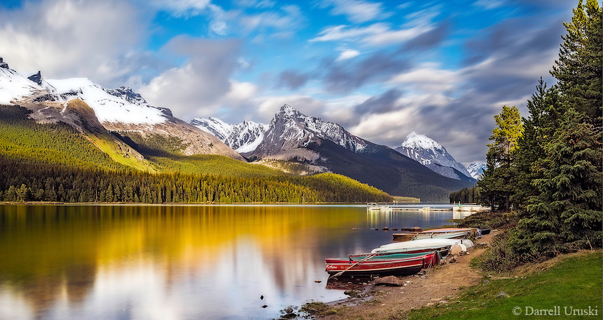 Fine Art Landscape Print Photograph of coloured mountain reflections in the still waters of Maligne Lake in Jasper Alberta, Canada.