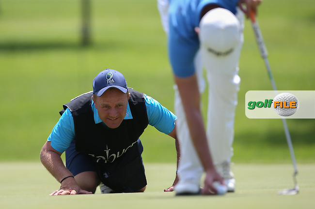 Dominic Bott goes low for the line of sight on the West Course during Round Two of the Joburg Open 2015 at the Royal Johannesburg & Kensington Golf Club, Johannesburg, Gauteng, South Africa. Picture:  David Lloyd / www.golffile.ie. 27/02/2015