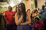 """Catholic worshippers attend a """"cure and liberty"""" mass, in the north zone, at the Parish of Our Lady of Graces, in Rio de Janeiro, Brazil, on Thursday, March 7, 2013.  The church is known for charismatic services, a movement which originated in the late 1960s, uses methods similarly to Evangelicalism using more audience participation and an all-around brighter tone where parishioners can sing and dance to songs. It's can also be referred to as ?Evangelical Catholicism?."""