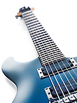 Blue Ibanez S-series electric guitar closeup of neck and pickups isolated at an angle on white background