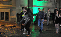 Pictured: A man gets a piggy back ride from his friend in the early hours of New Year's Day. Sunday 01 January 2017<br /> Re: Revellers out celebrating the New Year in the pub and club on Wind Street Swansea