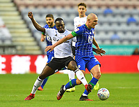 Wigan Athletic's Kal Naismith battles with Fulham's Neeskens Kebano<br /> <br /> Photographer Dave Howarth/CameraSport<br /> <br /> The EFL Sky Bet Championship - Wigan Athletic v Fulham - Wednesday July 22nd 2020 - DW Stadium - Wigan<br /> <br /> World Copyright © 2020 CameraSport. All rights reserved. 43 Linden Ave. Countesthorpe. Leicester. England. LE8 5PG - Tel: +44 (0) 116 277 4147 - admin@camerasport.com - www.camerasport.com