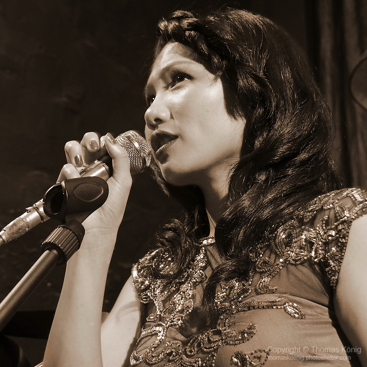 DC Stage, Kaohsiung -- Guest vocalist Lien Hsiao-Yun in a shot reminiscent of Shanghai in the 1930s.