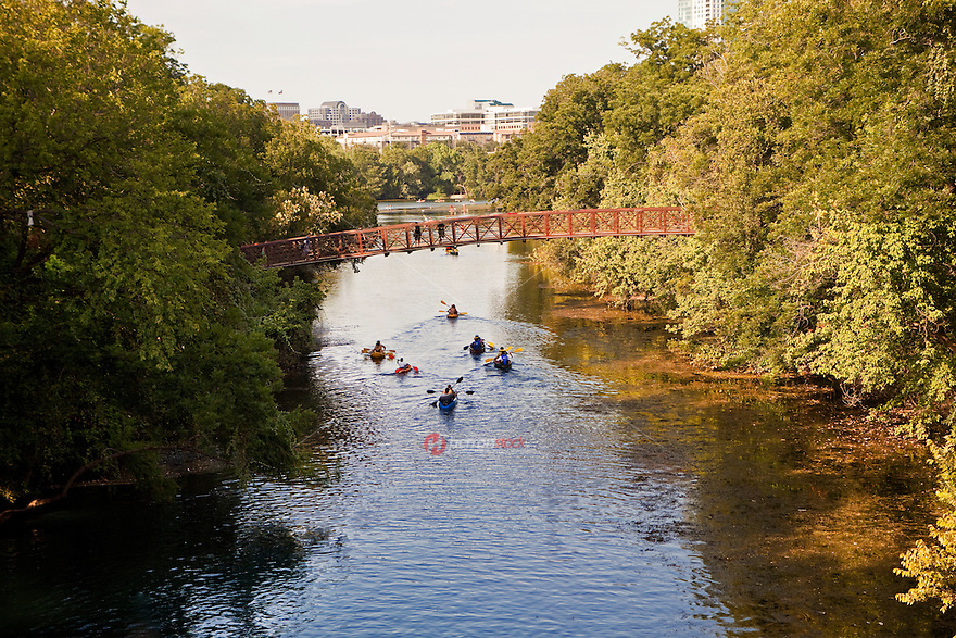 Canoes and kayaks navigate Barton Creek at Zilker Park, Austin, Texas